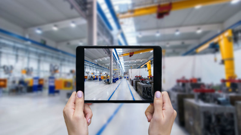 Photo being taken of the inside of a factory on a tablet