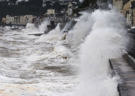 Waves crashing against sea wall in Dawlish