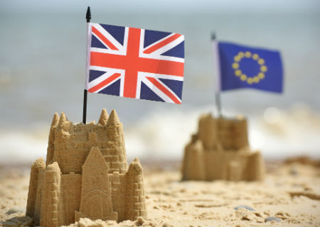 Union Jack and Euro flags in sand castles