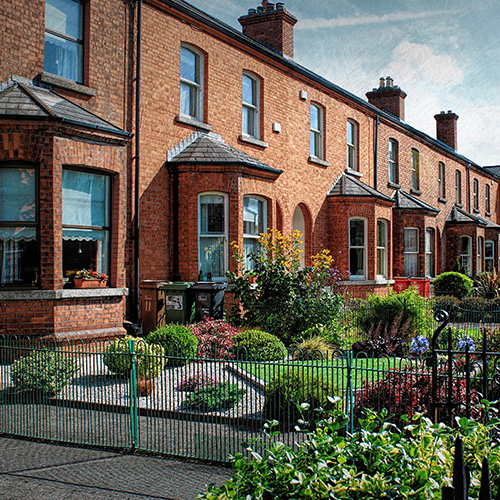 Front of terraced houses with gardens