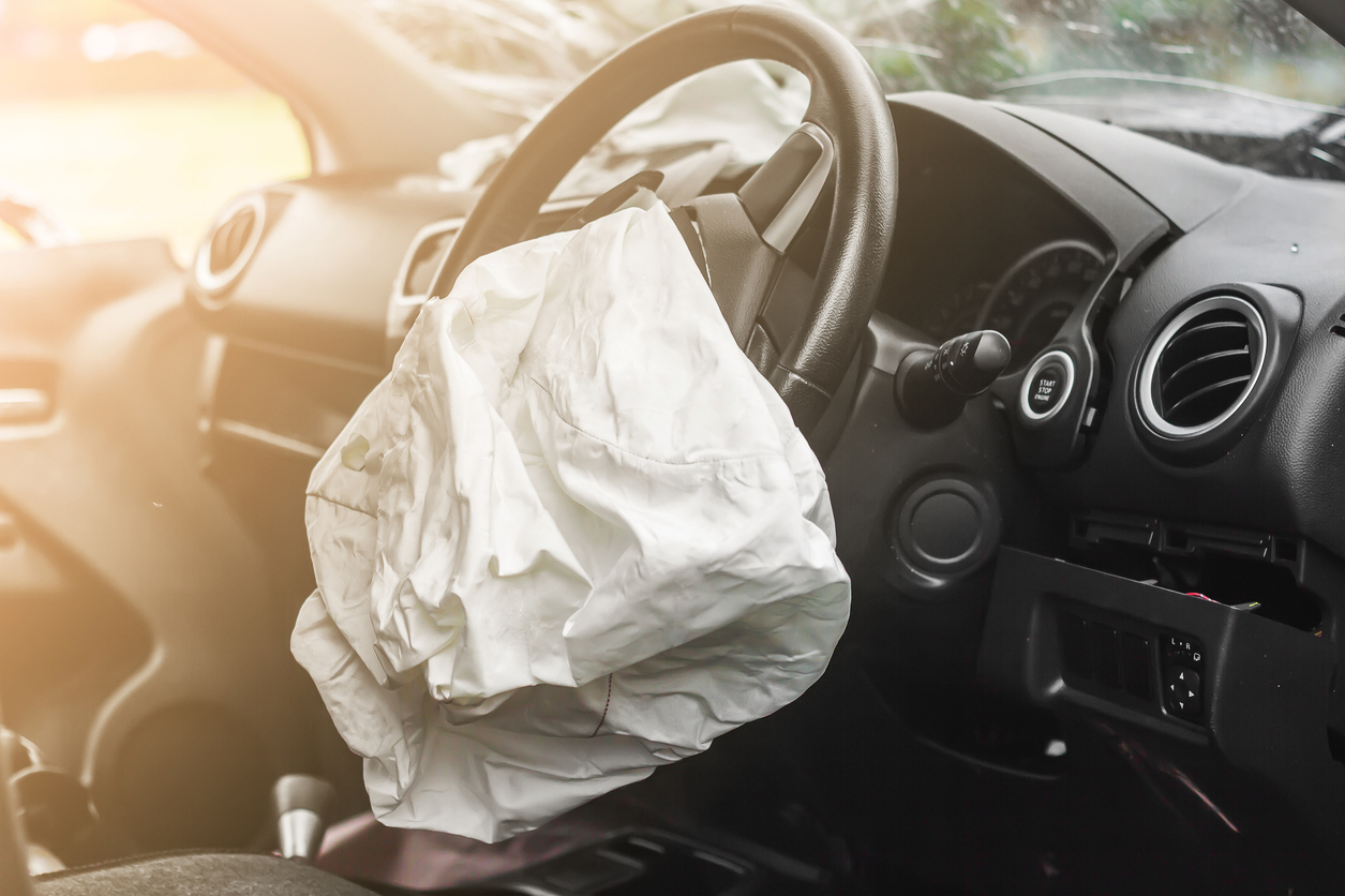 Car crashed interior with deflated airbag