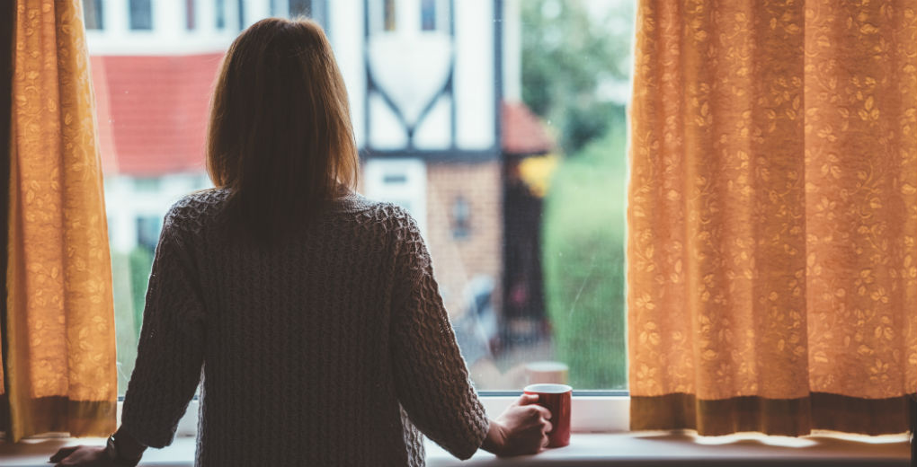 Prisoner's mum looking out of window to reflect convict insurance in Northumberland and Newcastle