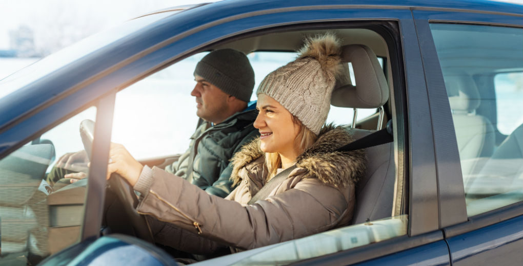 Couple driving car to reflect motor insurance in Northumberland and Newcastle